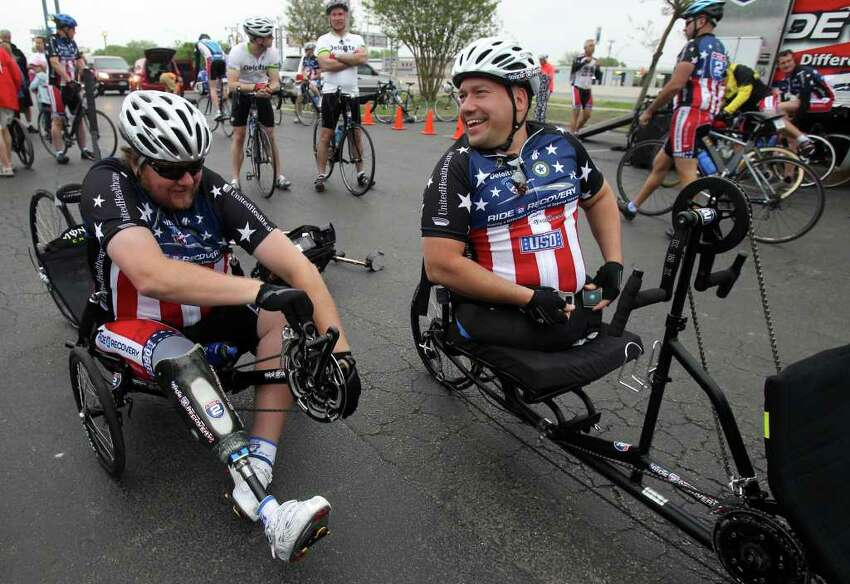Matt Walker (left) and Chuck Sketch (buckling up) prepare to head for the Center for the Intrepid at Fort Sam Houston on Monday, March 28, 2011, where the Ride 2 Recovery Texas Challenge started. The six-day, 350-mile ride to support rehabilitation for injured veterans began in San Antonio and will end in Arlington on Saturday, April 2. Walker is retired from the Army and Sketch is a former Marine.