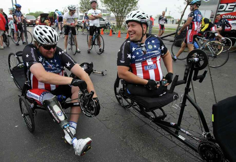 Matt Walker (left) and Chuck Sketch (buckling up) prepare to head for the Center for the Intrepid at Fort Sam Houston on Monday, March 28, 2011, where the Ride 2 Recovery Texas Challenge started. The six-day, 350-mile ride to support rehabilitation for injured veterans began in San Antonio and will end in Arlington on Saturday, April 2. Walker is retired from the Army and Sketch is a former Marine. Photo: John Davenport/Express-News / SAN ANTONIO EXPRESS-NEWS (Photo available to the public)