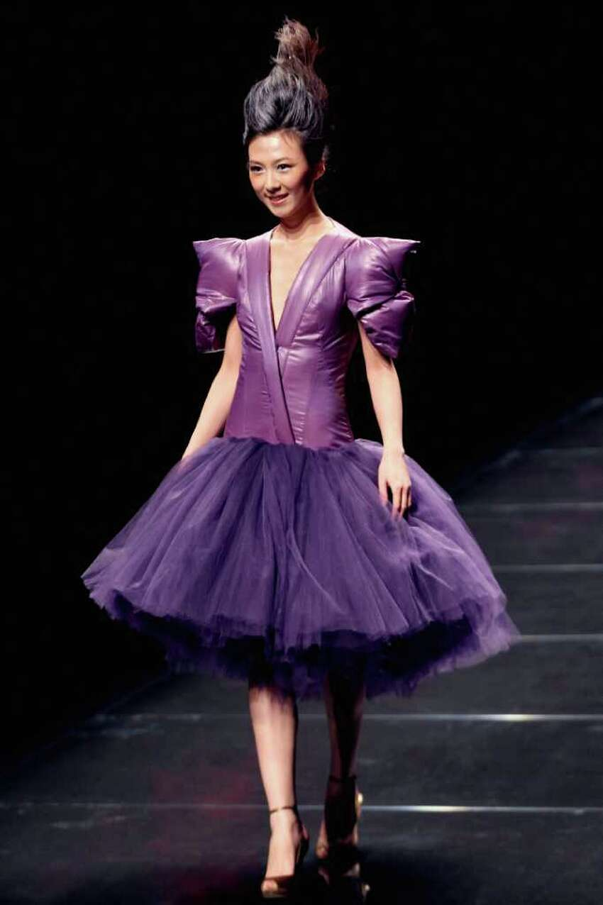 A model walks the runway at the Bosideng Fall/Winter 2011/2012 fashion show during on the Fifth day of China Fashion Week A/W 2011 on March 28, 2011 in Beijing, China.
