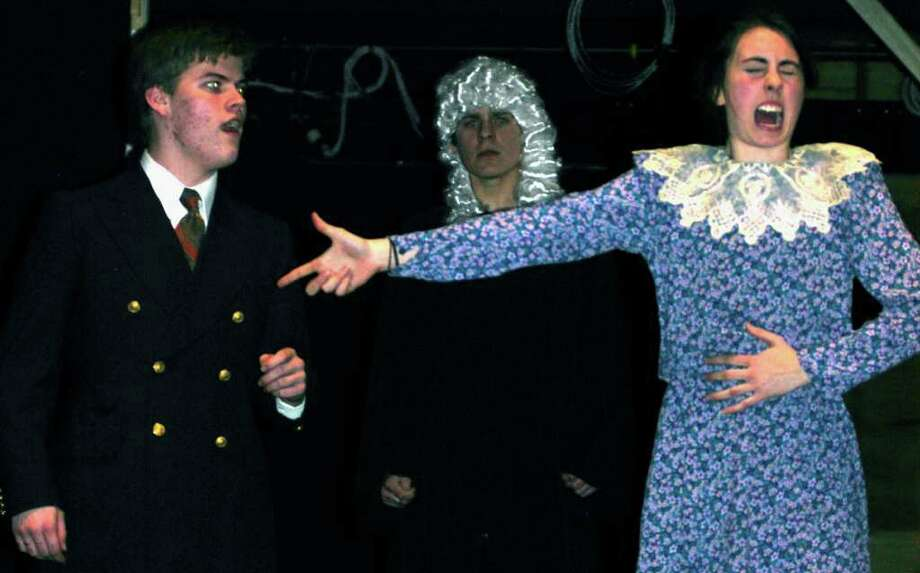 "SPECTRUM/For the benefit of sympathetic judge and jury, and exactly as instructed by Aaron Dwyer, left, as lawyer Bily Flynn, Callie Huber as Roxie Hart offers an animated rendition of how she shot a man in self-defense during dress rehearsal  for the Shepaug Valley High School musical production of ""Chicago."" The show will open March 25, 2011 at 8 p.m. and also be presented March 27 at 3 p.m. and April 1 and 2 at 8 p.m. at the school. For ticket information, call the school at 860-868-7326. Photo: Norm Cummings / The News-Times"