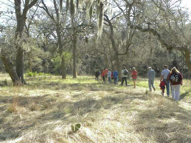 Nancy Gray leads a hike in the  Honey Creek State Natural Area. The area is part of  Guadalupe River State Park. Though most families come to the state park for the river, it also  has 5.3 miles of hiking trails.  Honey Creek State Natural Area is only open to the public by  guided hike. Photo credit: Tara Dooley / DirectToArchive