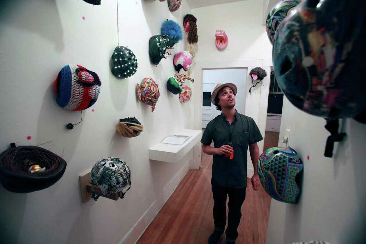 Mike Stolt checks out the helmet entries during The Long Table of Love, a fundraiser for Casa Chuck.