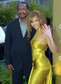 FILE - In this Feb. 8, 2004 file photo, singer Beyonce Knowles arrives at the 46th Annual Grammy Awards with her father and manager Mathew Knowles in Los Angeles. Photo: AP
