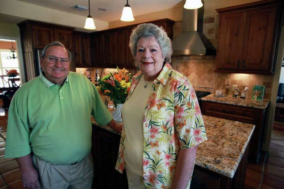 Jackie Fellers and Gene Willette opened their Shavano Park home kitchen to the family room, which helps those in the kitchen feel more connected during family gatherings. Photo: TOM REEL, SAN ANTONIO EXPRESS-NEWS / © 2011 San Antonio Express-News