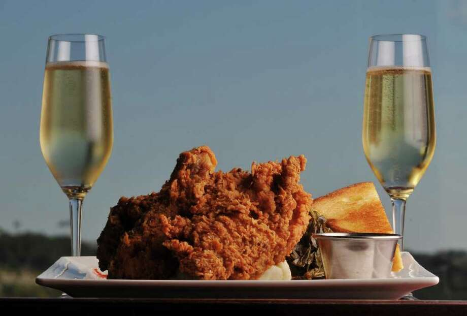 Max's Wine DiveAddress:340 E. Basse Road at Quarry Village, Suite 101, 210-444-9547Why we like it: The kitchen marinates the chicken in a house-made jalapeño and buttermilk mix before it's slowly deep fried. It's cooked to order, so snack on an appetizer while it's being prepared. For dinner, it's served with chipotle honey, mashed potatoes, collard greens and Texas toast. At brunch, wings and drummettes are served on top of pancakes. Top o' the morning to you! Photo: ROBIN JERSTAD, Photo By Robin Jerstad/Special To The Express-News / Robert Jerstad