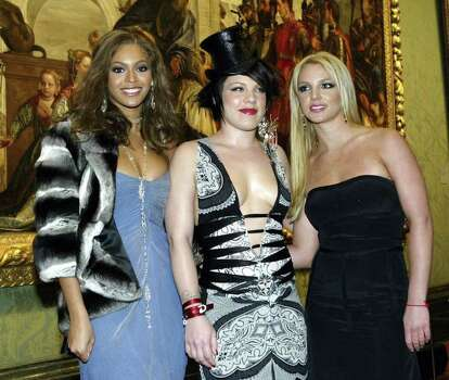 "LONDON - JANUARY 26:  Beyonce Knowles, Pink and Britney Spears pose for the cameras during the Premiere for the new Pepsi Music Commercial ""Pepsi Gladiators"" at the National Gallery in Trafalgar Square on January 26, 2003 in London, England. Photo: John Gichigi, Getty Images / 2004 Getty Images"
