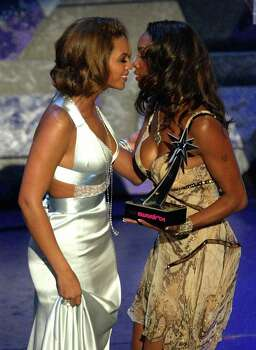 HOLLYWOOD - JUNE 29:  Actress Vivica A. Fox (R) presents Singer Beyonce with the award for Best Collaboration on stage at the 2004 Black Entertainment Awards held at the Kodak Theatre on June 29, 2004 in Hollywood, California. Photo: Kevin Winter, Getty Images / 2004 Getty Images