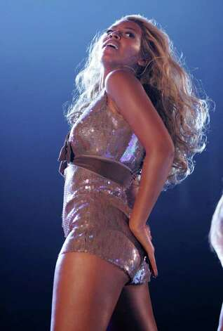 "NEW YORK - SEPTEMBER 8:  Beyonce performs on stage at the ""Fashion Rocks"" concert held at Radio City Music Hall on September 8, 2004 in New York City. Photo: Frank Micelotta, Getty Images / 2004 Getty Images"