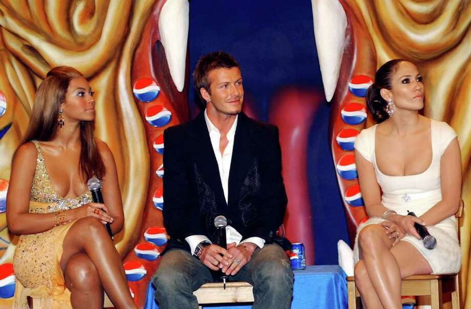 MADRID, SPAIN - FEBRUARY 23: Jennifer Lopez, Beyonce Knowles and  David Beckham attend the Premiere of the new Pepsi Advertisement at Circulo de Belles Artes on February 23, 2005 in Madrid, Spain. The advert is set in the mystical underworld of Hong Kong and stars Jennifer Lopez, Beyonce Knowles and David Beckham. (Photo by Carlos Alvarez/Getty Images) *** Local Caption *** Jennifer Lopez; Beyonce Knowles; David Beckham Photo: Carlos Alvarez, Getty Images / 2005 Getty Images