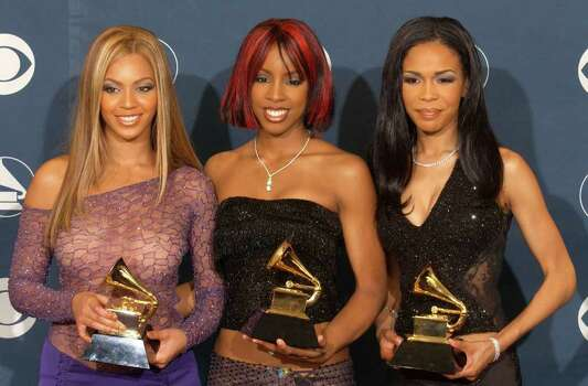 "401611 161: (L to R) Beyonce Knowles, Kelly Rowland and Michelle Williams of Destinys Child pose backstage during the 44th Annual Grammy Awards at Staples Center February 27, 2002 in Los Angeles, CA. Destinys Child won Best R&B Performance By A Duo or Group With Vocal for ""Survivor."" Photo: Vince Bucci, Getty Images / Getty Images North America"