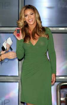 "NEW YORK - OCTOBER 11:  Singer Beyonce poses for a photo during a press conference to annouce the new ""B'Phone"" by Samsung at the Samsung Experience Store on October 11, 2007 in New York City.  (Photo by Scott Gries/Getty Images) *** Local Caption *** Beyonce Photo: Scott Gries, Getty Images / 2007 Getty Images"