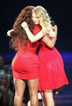 "NEW YORK - SEPTEMBER 13:  Taylor Swift (R) hugs Beyonce after she allowed her to finish her speech, that was cut short by Kanye West, after Beyonce won ""Best Video of the Year"" during the 2009 MTV Video Music Awards at Radio City Music Hall on September 13, 2009 in New York City.  (Photo by Christopher Polk/Getty Images) *** Local Caption *** Taylor Swift;Beyonce Photo: Christopher Polk, Getty Images / 2009 Getty Images"
