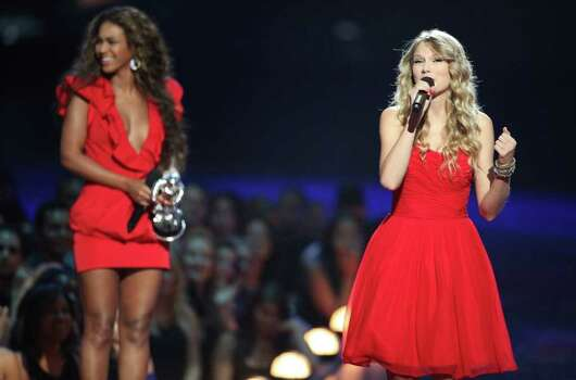 "NEW YORK - SEPTEMBER 13:  Taylor Swift (R) speaks after Beyonce (L) allowed her to finish her speech, that was cut short by Kanye West, after Beyonce won ""Best Video of the Year"" during the 2009 MTV Video Music Awards at Radio City Music Hall on September 13, 2009 in New York City.  (Photo by Christopher Polk/Getty Images) *** Local Caption *** Beyonce;Taylor Swift Photo: Christopher Polk, Getty Images / 2009 Getty Images"
