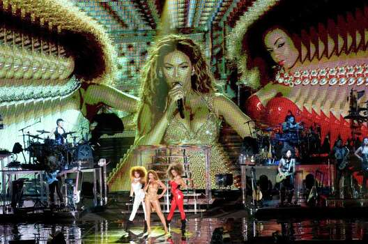SINGAPORE - SEPTEMBER 26:  Beyonce performs on stage on the third and final day of the three day F1 Rocks Singapore concert at Fort Canning Park on September 26, 2009 in Singapore. Photo: Alphonso Chan, Getty Images / 2009 Getty Images