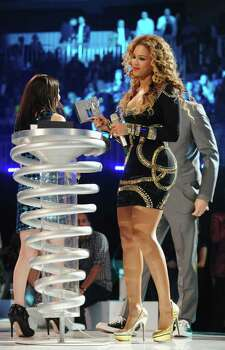 BERLIN - NOVEMBER 05:  Beyonce Knowles accepts an award during the 2009 MTV Europe Music Awards held at the O2 Arena on November 5, 2009 in Berlin, Germany.  (Photo by Dave M. Benett/Getty Images) *** Local Caption *** Beyonce Knowles Photo: Dave M. Benett, Getty Images / 2009 Getty Images