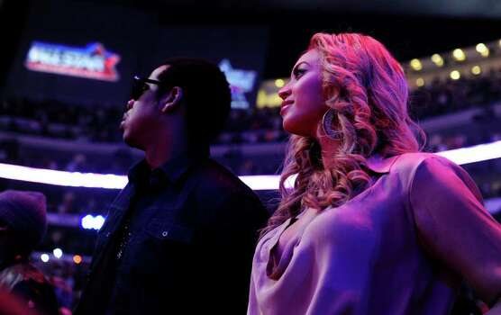 Jay Z and Beyonce stand for the national anthem before the start of the NBA All-Star Game February 20, 2011, part of NBA All-Star Weekend at Staples Center in Los Angeles, California. AFP PHOTO / Robyn Beck Photo: ROBYN BECK, AFP/Getty Images / 2011 AFP