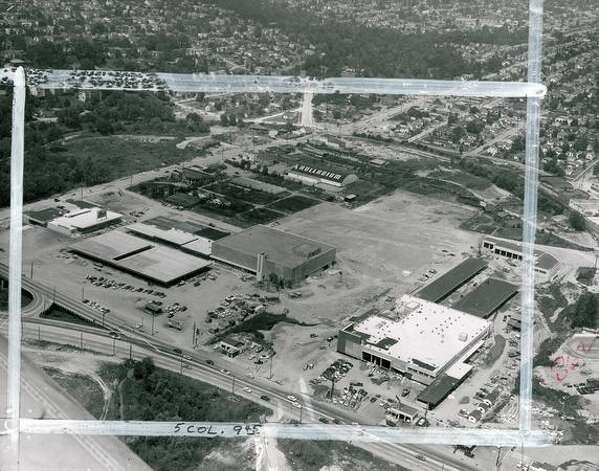 This P-I archive photo from July 1956 shows the construction of University Village and the Carnation plant, which is now where the QFC stands. (seattlepi.com file) Photo: P-I File
