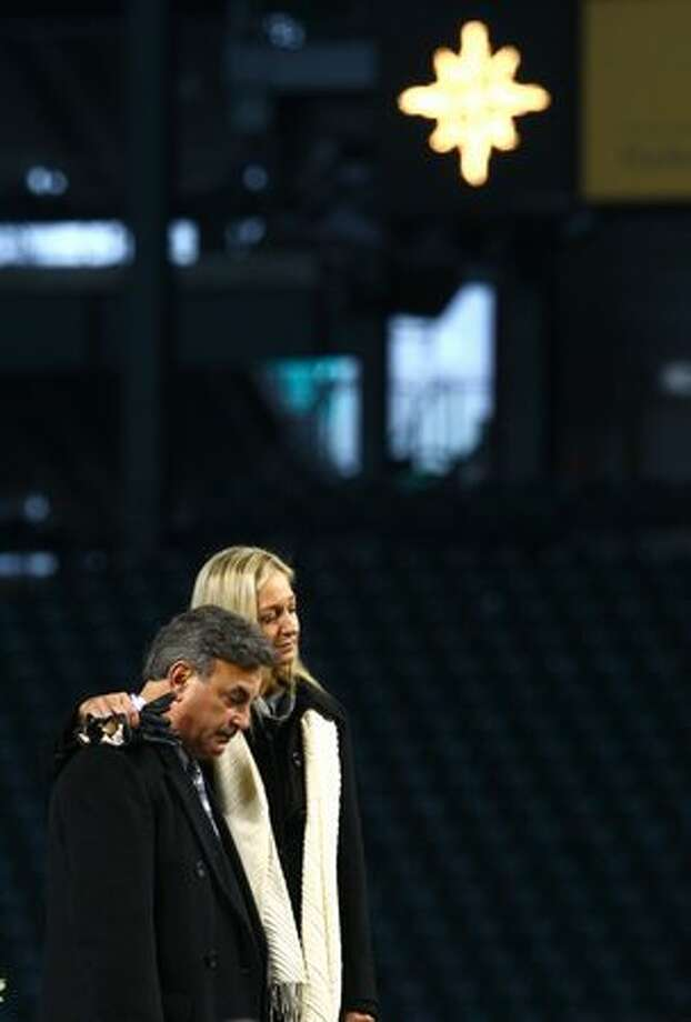 Greta Niehaus Dunn and Rick Rizzs embrace during a celebration of life ceremony for Seattle Mariners broadcaster Dave Niehaus. Photo: Joshua Trujillo, Seattlepi.com