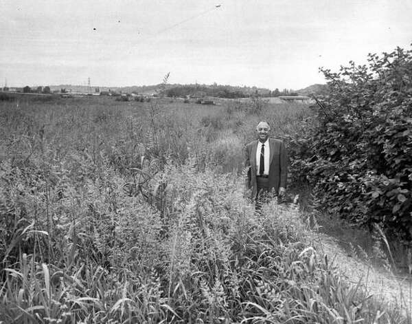 The June 1968 caption read: Mondo Desimoine stands in a weed grown field, part of 40 South Park acres where a Seattle stadium might go. He'll fight condemnation through the U.S. Supreme Court. Photo: P-I File