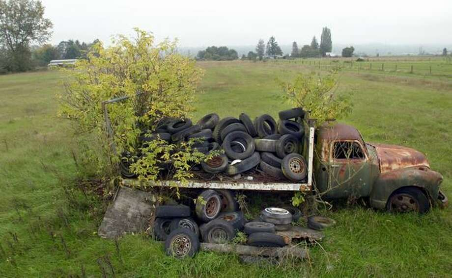 A forgotten truck sprouts trees in a field on the northern edge of Site A, where promoters in 2004 said a NASCAR track may be built near Arlington Airport. (Joshua Trujillo/Seattlepi.com file) Photo: P-I File