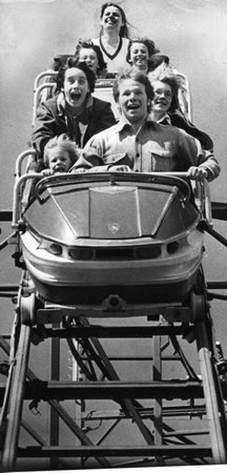 The April 1976 P-I photo caption read: With one small exception, these passengers on the Galaxie, one of the most popular rides at Seattle Center's Fun Forest, seem to be having the time of their lives. (Grant M. Haller/Seattlepi.com file) Photo: P-I File