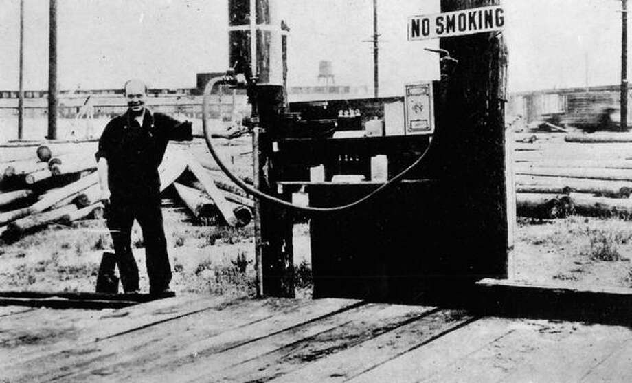 The photo captions reads: The world's first drive in service station, consisting of a hot water tank, a piece of heavy garden hose and a few lubricating products, looked like this when it opened for business in Seattle. (1907?) [Read more here.] Photo: P-I File