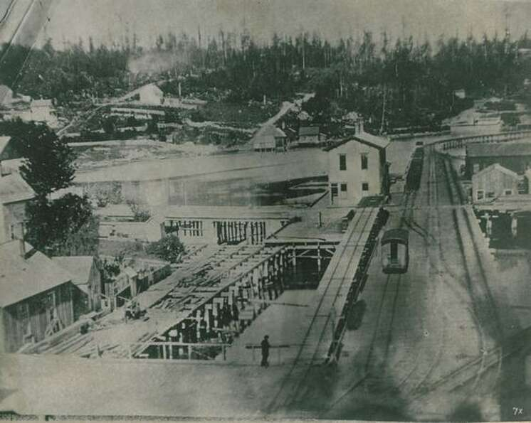 The photo caption indicates this is Seattle's first railroad terminal, circa 1882.