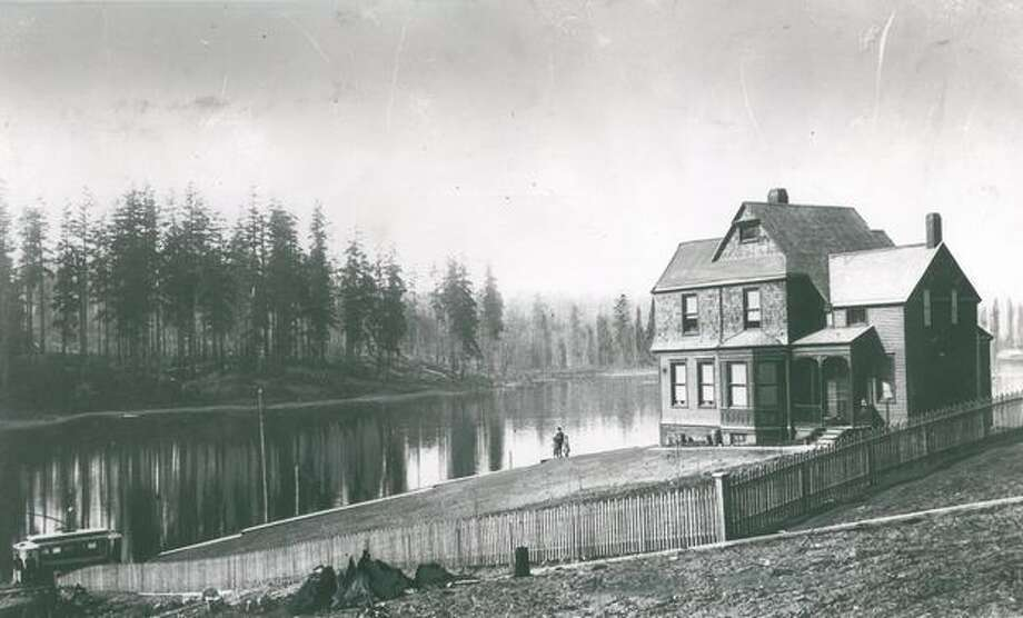 The caption for this photo reads: Looking towards Green Lake in 1890. This house was built in that year by Judge F.A. McDonald. The Judge and his two sons and daughter are seen in the photograph. Photo: P-I File