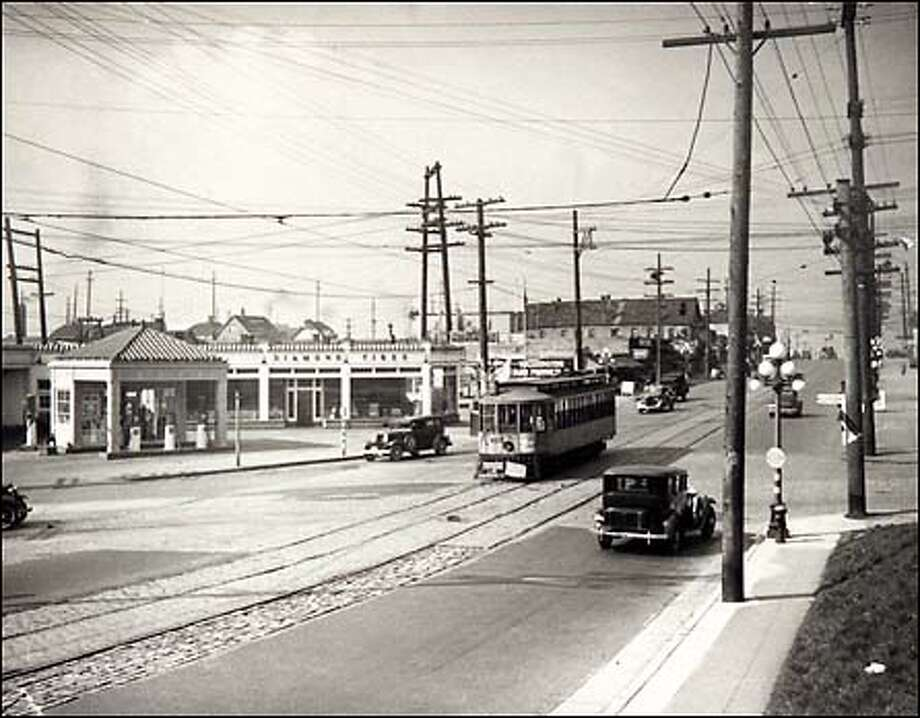 From the P-I archives: Steep slopes in the area have always set the neighborhood apart from the rest of the city. By 1888, the wagons that ran up Yesler Way were replaced by electric streetcars. Here, a trolley runs on Jackson Street at 14th Avenue in 1936. Photo: P-I File