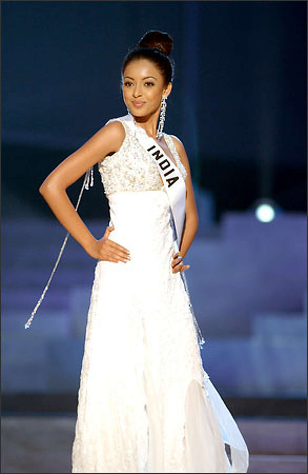 Tanushree Dutta, Miss India, competes in an evening gown of her choice during the 2004 Miss Universe Presentation Show at CEMEXPO in Quito, Ecuador on May 27. Each delegate is judged by a preliminary panel of distinguished judges in three categories consisting of individual interviews, swimsuit competition and evening gown competition. The scores will be tallied and the top 15 delegates will be announced during the NBC broadcast of the 53rd annual Miss Universe competition from Quito on June 1 at 9 p.m. (delayed PT).