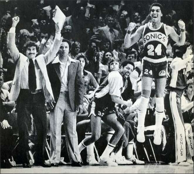 From left: SuperSonics assistant coach Les Habegger, head coach Lenny Wilkens, team captain Fred Bro
