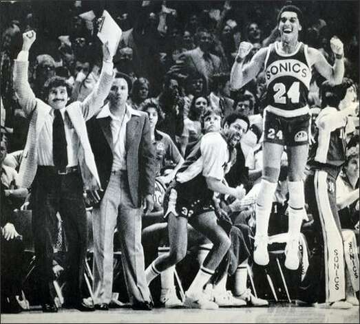 From left: SuperSonics assistant coach Les Habegger, head coach Lenny Wilkens, team captain Fred Brown and Dennis Johnson celebrate as their 1979 championship win over the Washington Bullets neared. Photo: Seattlepi.com