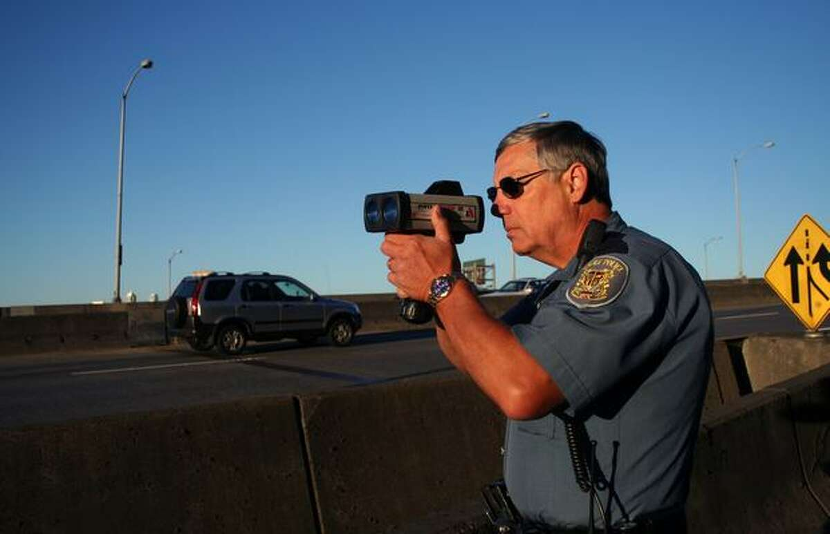 Seattle police officer J. Dean Shirey looks to catch speeders on the West Seattle Bridge.