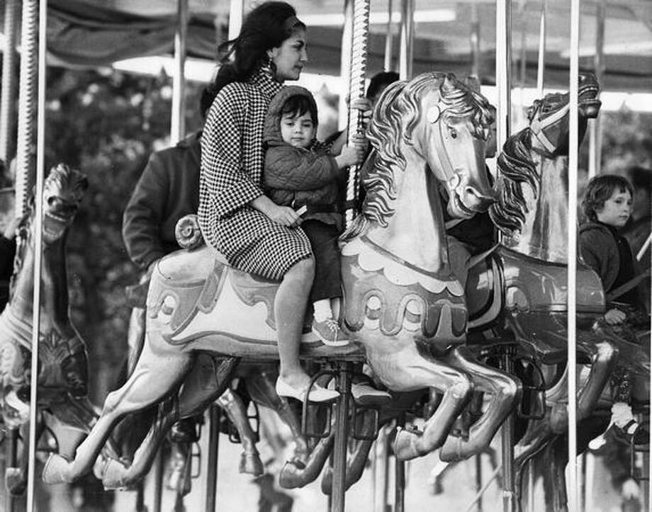 The original photo caption read: Mrs. Henry Dutcho with Sean, 1 1/2, at the Seatle Center Fun Forest on opening day. Photo: P-I File