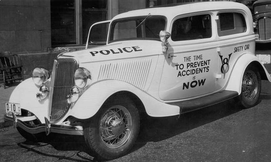 Police departments new accident prevention automobile which will cruise downtown streets, warning jay-walkers and careless motorists by means of a powerful broadcasting apparatus as part of Seattle's traffic educational campaign. August 15, 1934. Photo: P-I File