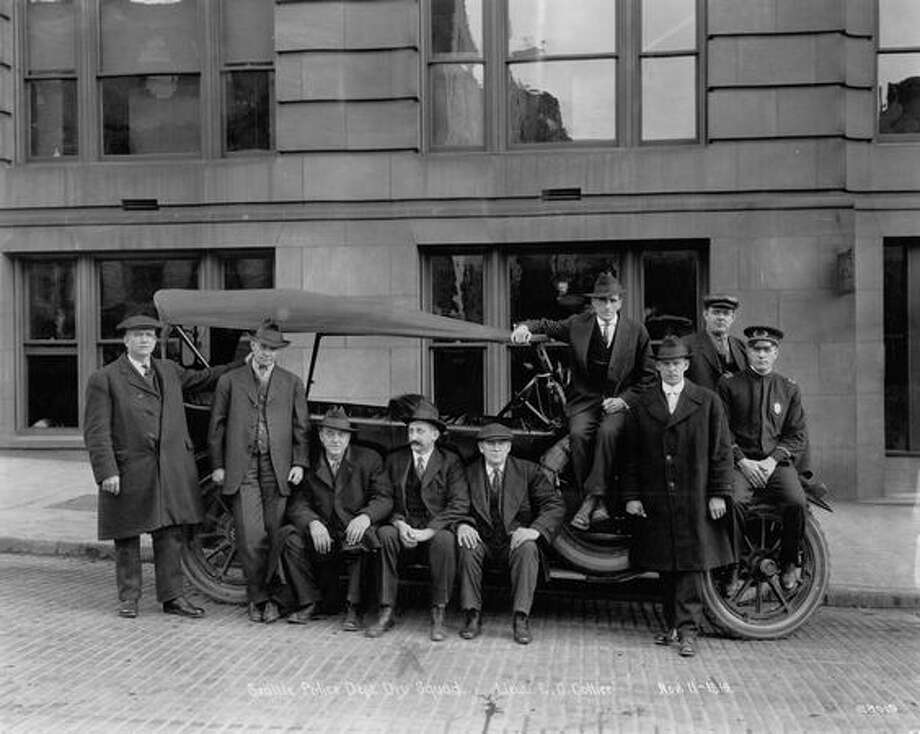 Picture No. 11, Dry Squad. From left to right--Guy H. Bowers, L. Gardner, Aldrich Smith, F.J. Phillips, J.O. Revelle, H McDonah, Fred Bralliard, C.O. Legate, Lieut. E.C. Collier. November 11, 1919. Photo: P-I File
