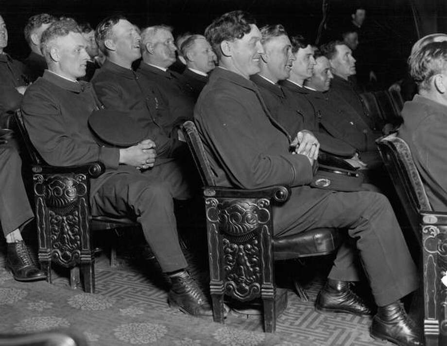 "A group of Seattle policemen watching a preview of ""The Gragnet"" at the 5th Avenue Theatre yesterday. May 25, 1928. Photo: P-I File"