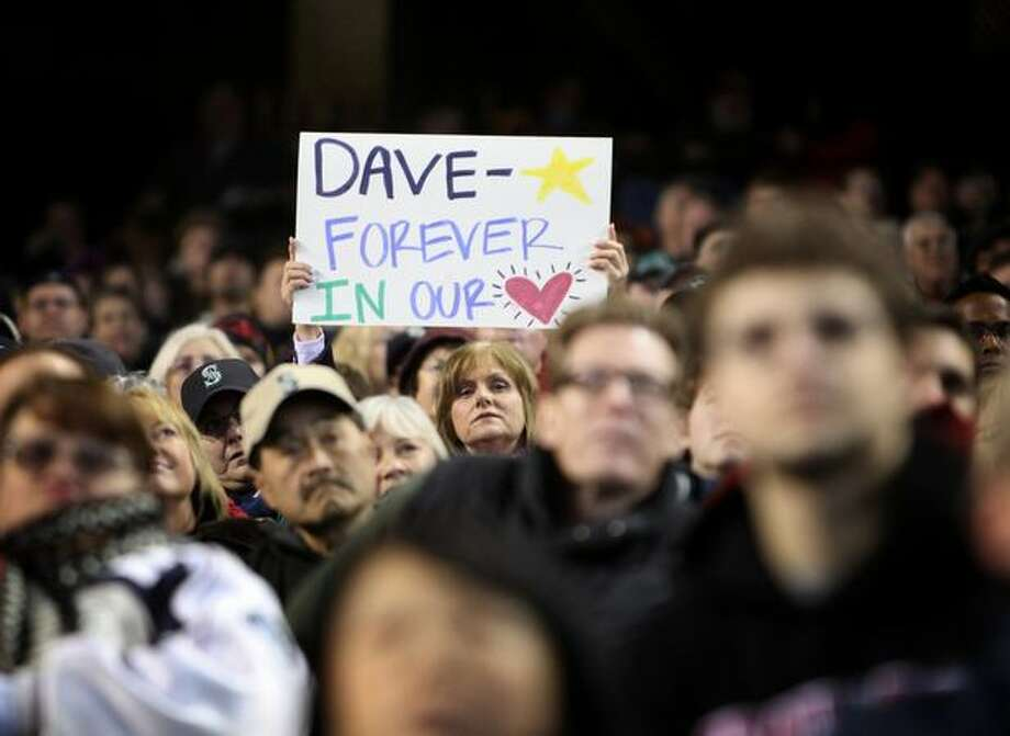 A fan holds up a sign during a celebration of life ceremony for Seattle Mariners broadcaster Dave Niehaus on Saturday, December 11, 2010 at Safeco Field. The longtime voice of the Mariners passed away last month. Thousands of fans gathered to honor Niehaus. Photo: Joshua Trujillo, Seattlepi.com