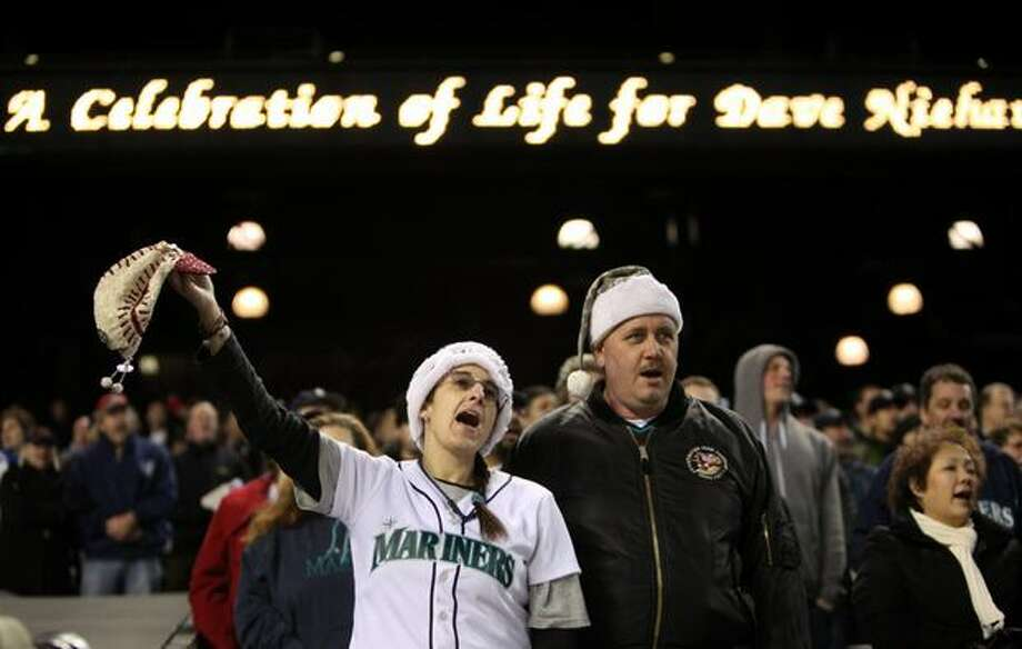 "Amy Franz and Joe Franz of Algona sing ""Take Me Out To The Ball Game"" during a celebration of life ceremony for Seattle Mariners broadcaster Dave Niehaus. Photo: Joshua Trujillo, Seattlepi.com"