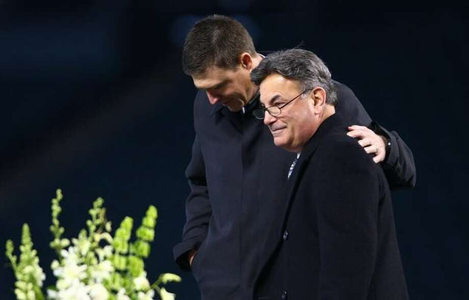 Former Mariner Dan Wilson embraces Rick Rizzs during a celebration of life ceremony for Seattle Mariners broadcaster Dave Niehaus. Photo: Joshua Trujillo, Seattlepi.com
