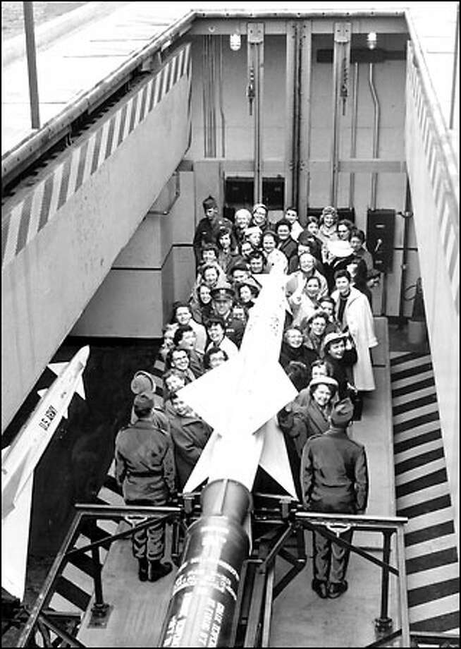 Women on tour of missile site, 1957: Crowded onto a giant elevator, a group of Army wives this surface-to-air missile installation in the Lake Forest Park area Feb. 14, 1957.  This was one of 12 Nike missile sites that ringed Seattle in the 1950s. They were considered vital to the nation's defense early in the Cold War. Photo: Seattle Post-Intelligencer