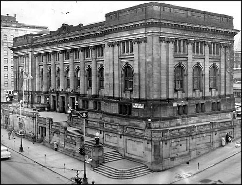 "Central library, 1956: The Seattle Public Library's central building, funded by Andrew Carnegie, opened its doors on Dec. 19,1906. The grand Beaux Arts-style structure remained in service until 1957; by then, many considered it a ""community eyesore."" It was torn down, and a new library was built on the site. Photo: Seattle Post-Intelligencer"