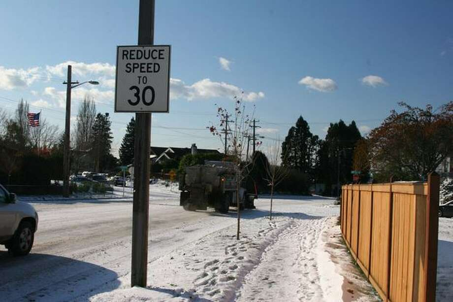 With many streets still covered by ice and snow, traffic often flowed well below the posted speed limit. Photo: Michelle Nicolosi, Seattlepi.com