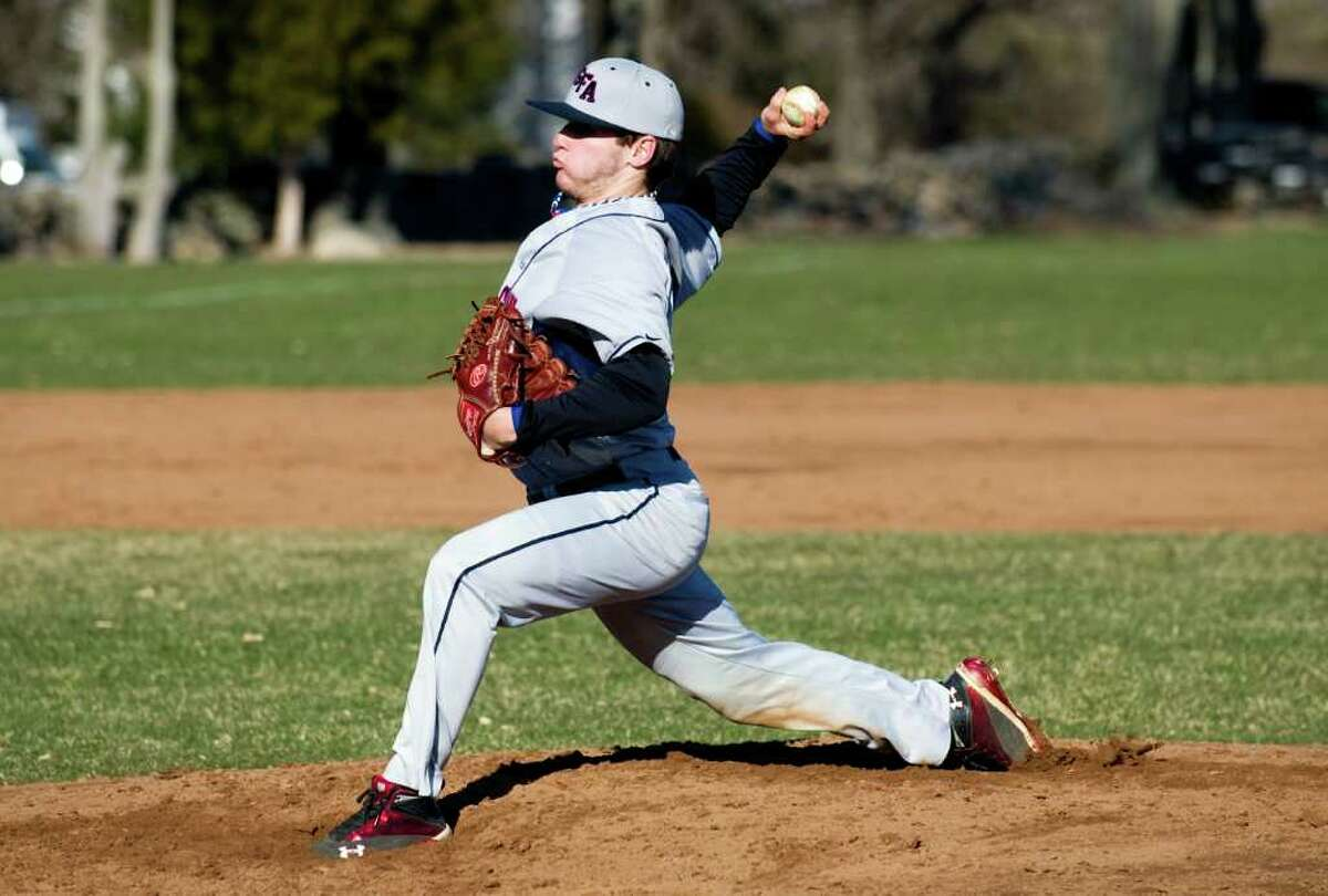 GFA's Henry Van Zant throws as King School hosts Greens Farms Academy in a boys baseball game in Stamford, Conn., March 29, 2011.