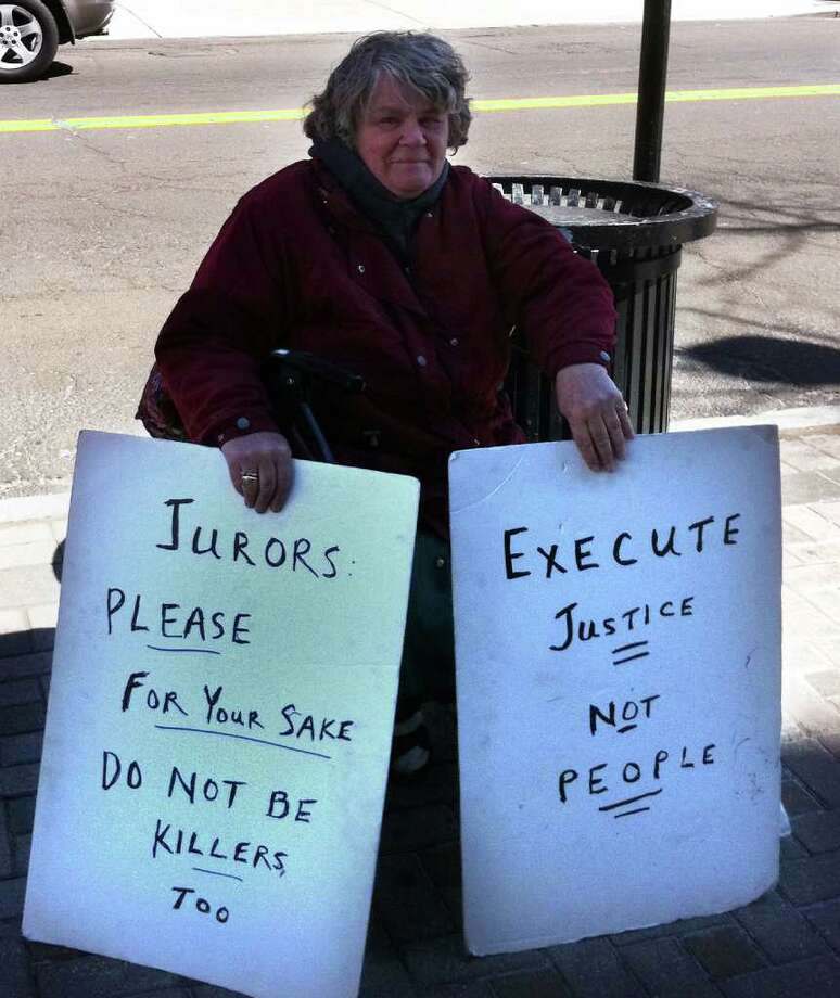 Clare Hogenauer, a retired N.Y. lawyer, protests outside Superior Court in Bridgeport, Conn. March 29th, 2011, where a jury deliberating the sentence of Christopher DiMeo. Photo: Dan Tepfer, Frank Juliano / Connecticut Post