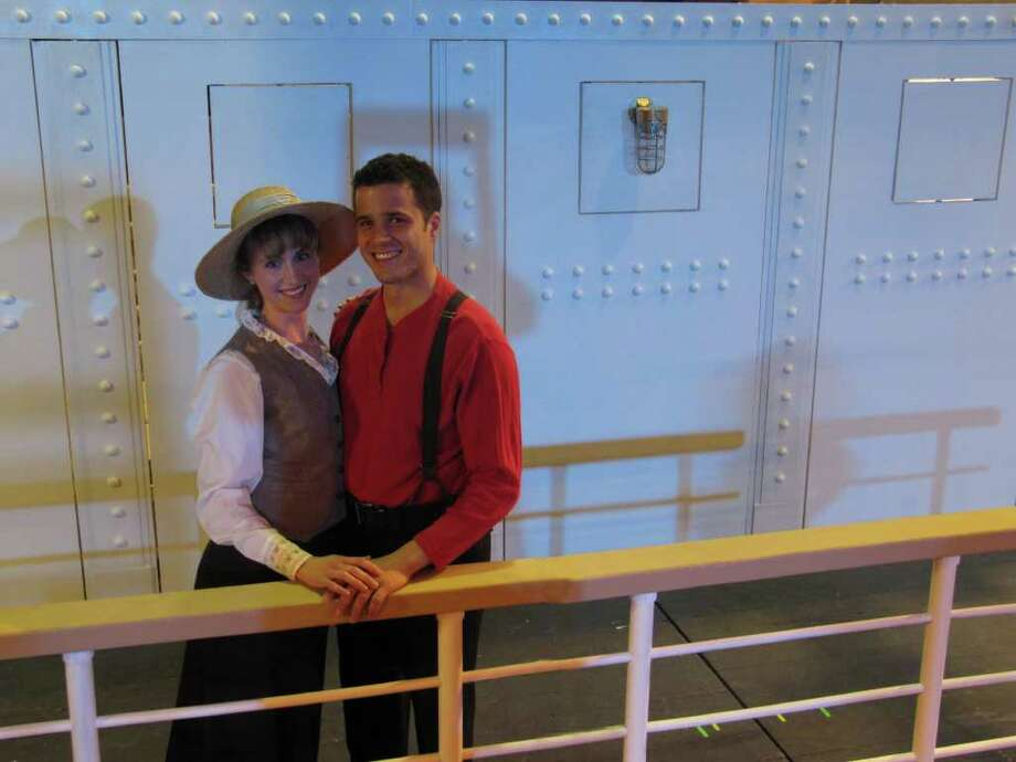 Rebecca Craig of Stamford and Christian Cardozo of Bridgeport stand on deck of the RMS Titanic. They are two of about 40 cast members who will tell the story of 'Titanic,' at Curtain Call's Kweskin Theatre, beginning April 1. The award-winning musical runs through April 30. Photo: Contributed Photo / Stamford Advocate Contributed