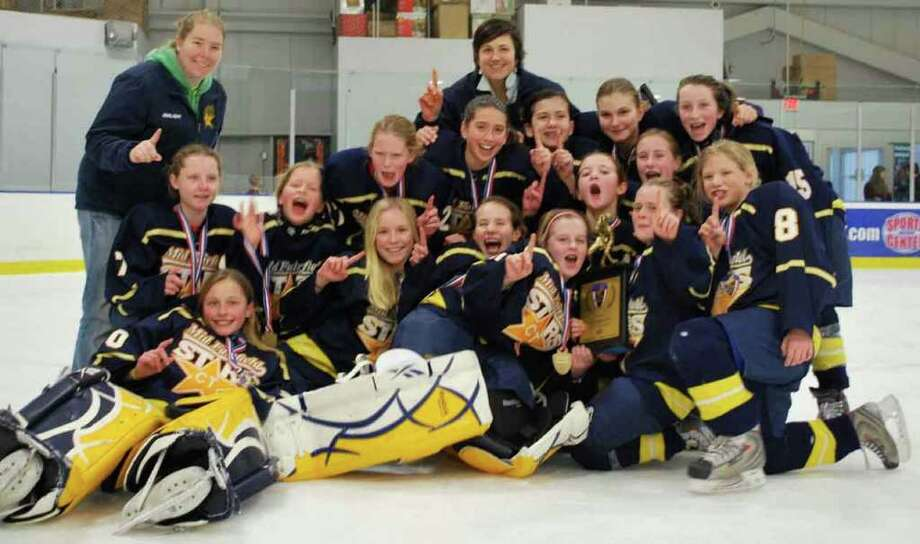 Led by coaches Caitlin Barnes and Kate DeForge, both from Norwalk, the Mid Fairfield Connecticut Stars U12-1 hockey team earned a spot in the USA Hockey National Championships this April in Detroit. Pictured are (back row) Courtney DeNaut, Annabel Nottembaum, Meghan Halloran, Caroline Silk, Gillis Frechette, Lauren Hoey. (Middle row) Sarah Ince, Isabella Marciano. (Back row) Assistant coach Kate DeForge, Anna Rassmussen, Katherine Somerby, Courtney Scheetz, head coach Caitlin Barnes, Amanda Hendry, Emma Siefert, Kate Palliota. Photo: Contributed Photo / Norwalk Citizen