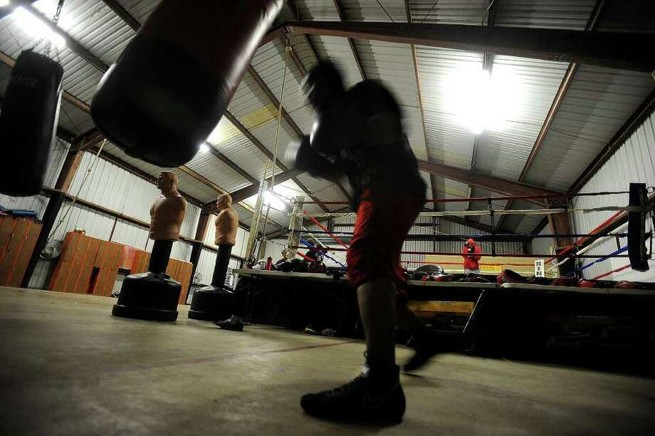 Chad Broussard hits a heavy bag at Kings Gym in Orange on Monday. Guiseppe Barranco/The Enterprise Photo: Guiseppe Barranco / Beaumont