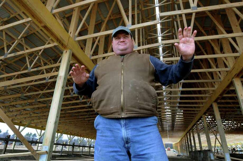 Jan King, who owns Kings Ransom Farm with his brother Jeff, talks about the new barn that's being built on Tuesday, March 29, 2011, at Kings-Ransom Farm in Northumberland. The original barn collapsed from a heavy load of snow. (Cindy Schultz / Times Union) Photo: Cindy Schultz