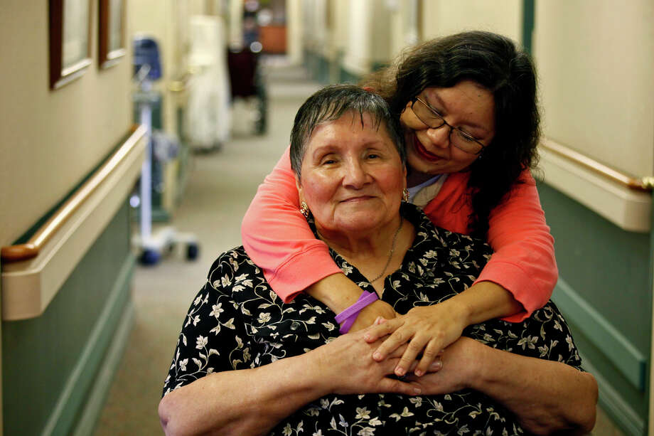 Cynthia Ann Garcia was the primary caretaker for her mother, Theresa Klonek Garcia, for seven years at home before moving her to Morningside Manor. A conference on planning for the care of aging parents will be held Thursday. Photo: LISA KRANTZ/lkrantz@express-news.net / SAN ANTONIO EXPRESS-NEWS